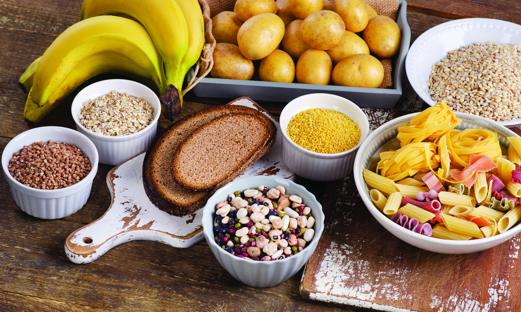 53650352 – Foods High In Carbohydrate On Wooden Table. Top View