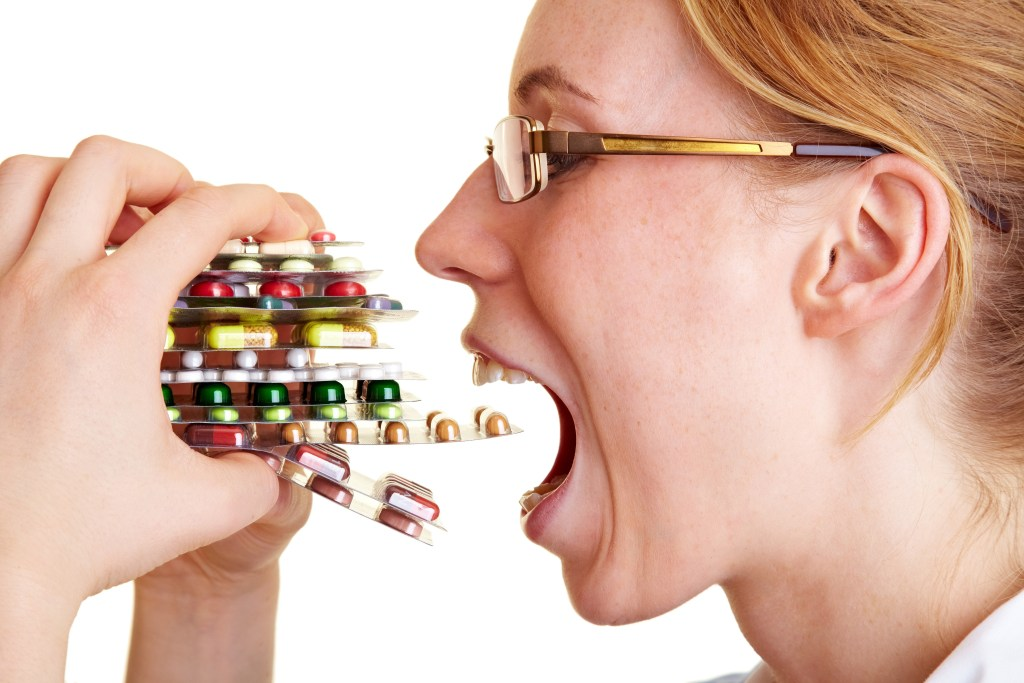 Woman Eating Pills