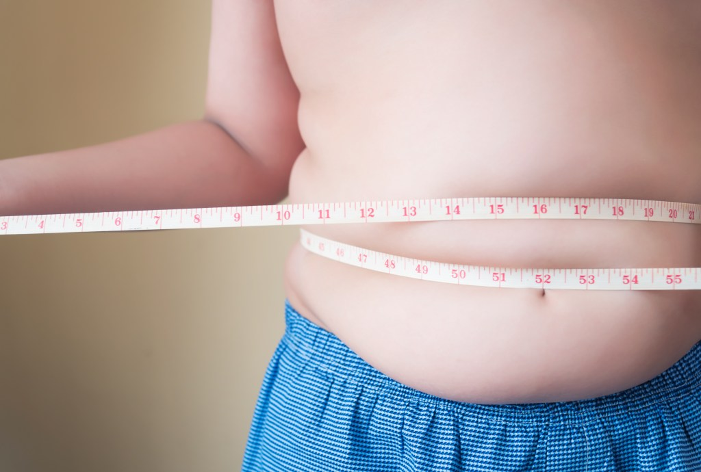 Fat Boy With Overweight Checking